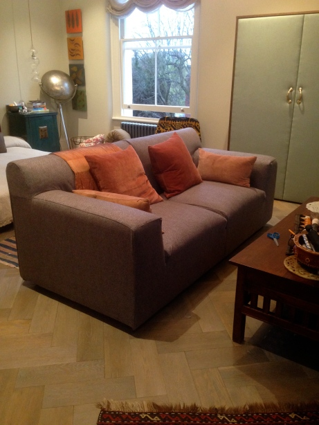 loose sofa cover and upholstered wardrobe doors