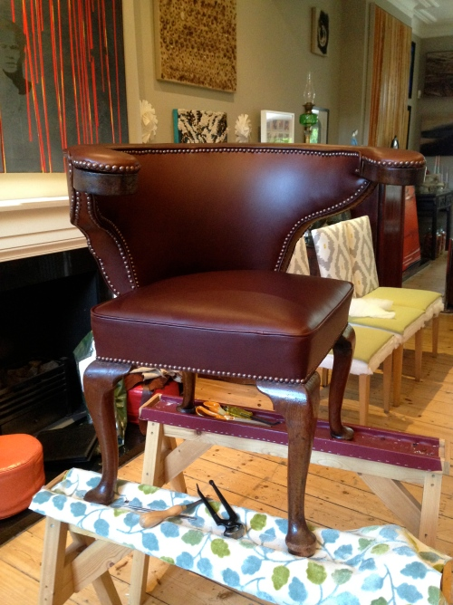 traditionally rebuilt seat, covered in alma leather, finished with antique studs