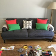 Country style sofa with modern tweed cushions